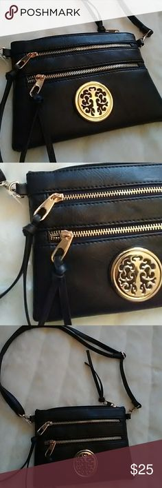 Crossbody bag black NWT This is a very cute crossbody bag in black with gold hardware. It has two zip pockets outside and one inside with one additional multi purpose pocket inside. Measures approximately 8.5 Length and 6.5 Height. Can be adjusted to Crossbody or regular length. Bags Crossbody Bags