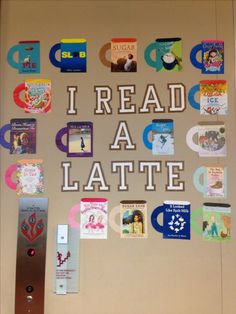 """Library winter beverages themed bulletin board. """"I read a latte."""" Mugs out of beverage themed book covers."""