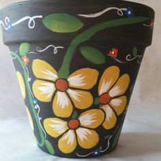 Bright yellow flowers, hand painted flower pot. So pretty!