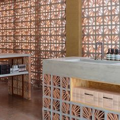 The Campana brothers chose to plan their whole design of this shop around the use of Cobogó a type of hollow ceramic block that is typically used across South America to allow ventilation and lighting to filter gently into buildings.