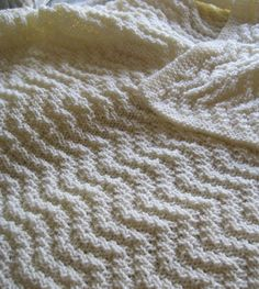 Free Knitting Pattern for Reversible Quick Knit Blanket - This reversible throw features a zigzag chevron texture. 104 x 147 cm (41″ x 58″). Rated easy byRed Heart Design Team. Pictured project bydmn0813