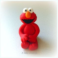 Elmo sugarpaste cake topper. I saw alot of bad elmos around, so I was a bit worried, however he turned out great!