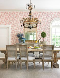 Lillian furnished the space with a Swedish-inspired dining table and sideboard. The rustic tabletop and the sideboard's hand-rubbed finish downplay formality. The room's one dressy note is a crystal chandelier Lillian designed, with inspiration from a Russian antique
