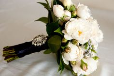 Beautiful Wedding Bouquet. White Roses with Silver Berries. Satin Ribbon with Crystal and Pearl Brooch.