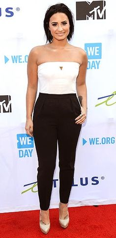 Demi Lovato in a white and black jumpsuit