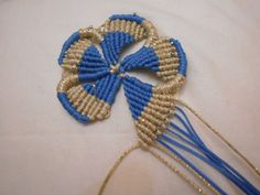 Russian - flower- macrame picture tute. (Translate but excellent step by step pictures)