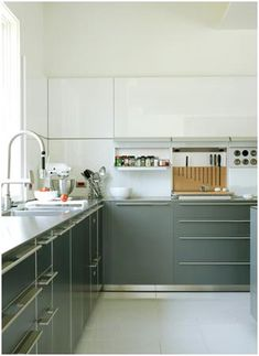 Renew old cabinets and add depth to your kitchen with a two-tone paint and finish treatment, Two toned cabinets, Two tone cabinets, Painted kitchen cabinets, Two tone kitchen cabinets, Two toned kitchen and Two tone cabinets.