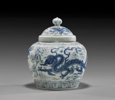 "EXTREMELY RARE MING BLUE & WHITE JAR. Extremely rare, Chinese early Ming Dynasty Imperial blue and white, 15th Century porcelain jar; of well potted form, the cover and body with design of three-clawed dragons, all against a leafy melon background; Chenghua Period with Imperial Tian mark; H: 7"" (approx.)"