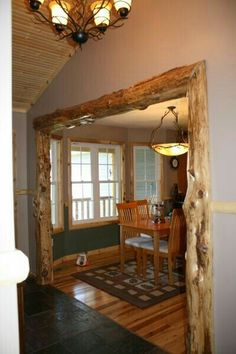 This rustic trim would look great at cabin to separate dining room from living room; need much darker stain though. Rustic Framing - Futura Home Decorating Cabin Homes, Log Homes, Western Decor, Rustic Decor, Rustic Chic, Rustic Livingroom Ideas, Rustic Entry, Shabby Chic, Rustic Office