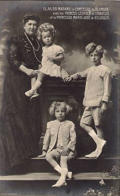 Royal Big Hair, 1910. The Dowager Countess of Flanders, Princess Marie-Jose, Prince Charles, Prince Leopold of Belgium.