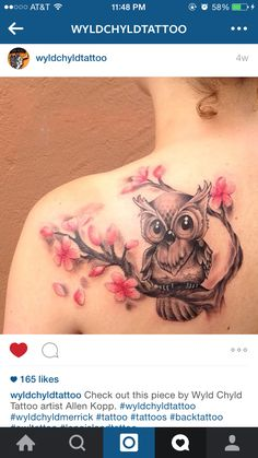 Owl and cherry blossom tattoo