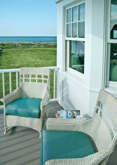Inviting beach house porch with white wicker furniture and turquoise cushions. I NEED A PORCH