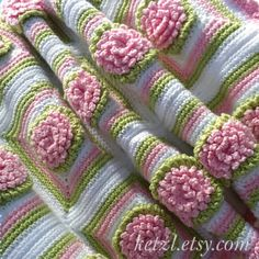Pattern 026  US crochet stitches.  This blanket features chrysanthemum flowers and a ruffle edging, and measures approx 83x68cm. Use a 3mm hook and a