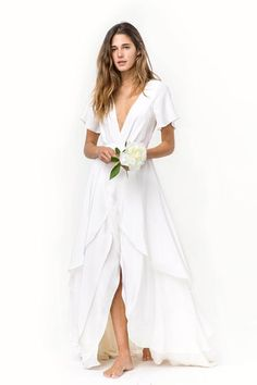 This was made for walking down an aisle of sand. #refinery29 http://www.refinery29.com/beach-wedding-dress-ideas#slide-4