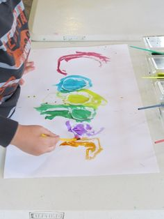 Students paint over hot glued names. Watercolor Names by Teach Preschool