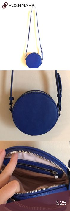 """Aritzia blue Circular Crossbody 2 compartments Adorable blue cylindrical crossbody with 2 zippered compartments. One has a compartment that fits my iPhone 7 perfectly and the other has a small inner zippered compartment. Zippers have cute little emojis on them. Perfect condition other than the white mark pictured which could probably come out but I haven't tried yet (not really noticeable). I got it from Aritzia and the brand is Sunday Best. Circumference is about 7""""  Make me an offer…"""