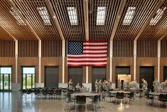 Cladding scale & density. Structural columns clad in drywall act as columns in ceiling that hold the light fixtures  Colonel James Nesmith Readiness Center THA Architecture
