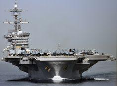 USS Carl Vinson transits the Strait of Hormuz..    ARABIAN SEA (Feb. 16, 2012) The Nimitz-class aircraft carrier USS Carl Vinson (CVN 70) transits the Strait of Hormuz. Carl Vinson and Carrier Air Wing (CVW) 17 are deployed to the U.S. 5th Fleet area of responsibility. (U.S. Navy photo by Mass Communication Specialist 3rd Class John Grandin/Released) 120216-N-BC134-478