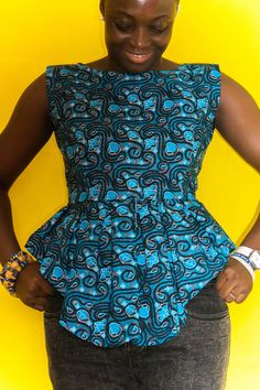 African print top with a dip hem peplum and a low v back. AFRICAN PRINT #Ankara #top #peplum