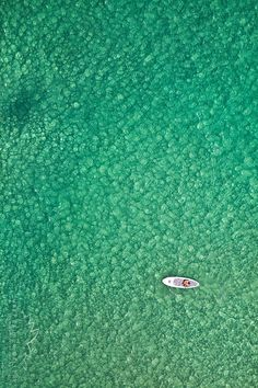 Bondi Beach, Sydney, Australia. What an amazing bird's eye view! Boat in the water at Bondi Beach. Green sea. Repin this for later. Such great travel photography.