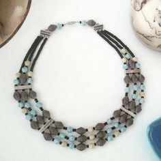 Multi-strand paper bead necklace by FromPaperToYarn on Etsy