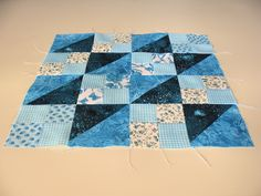 "A traditional pattern called ""New 4 Patch"" or ""World's Fair"": Composed of 4 patch squares and half square triangles.  Pieced by Pam Wilson in July 2014, incorporating gingham and other fabrics from the stash of my aunt Johanna Wackerle Tanner."