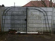 Bespoke 6ft wrought iron gates complete with design posts + arch frame. JOB LOT