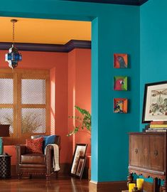 COLOR HARMONY: This is a split-complementary color scheme. The oranges on the back walls and ceiling are not true oranges; one is more red, and the other is more yellow.