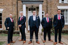 Groomsmen / ushers wearing dark blue suits with waistcoats, and pink / claret ties. Image by Sally Rawlins Photography. Dark Blue Suit, Blue Suits, Wedding Blog, Wedding Styles, Wedding Venues, Ushers, West Ham, Groom Style, Wedding Groom