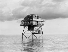 Deactivated light station on stilts located near the entrance to the Northwest Channel leading into Key West, Florida. Photographed in June 1949 by Joseph Janney Steinmetz.