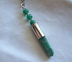 Green Aventurine Onyx Beads Silver Bullet Pendant -  Because it attracts wealth and abundance through opportunity, it is often used as a lucky talisman and is a popular stone for gamblers. Carry one in your pocket and be ready to accept opportunity when it comes your way.