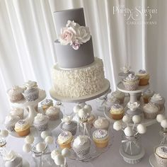 Grey and white ruffles wedding cake cake dessert table with coordinating cupcakes and cake pops