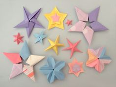 diy galaxy of origami stars - so cool! I think I might make these for the ceilings in the kids room and maybe put some glow in the dark paint on them.  Hmmm