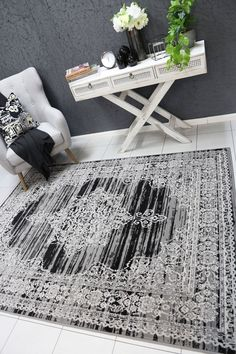 Runiullae Modern Classic Dark Grey Rug A marvelous exhibit of trendsetting rugs, this Collection instills life into extraordinary spaces. Expertly power-loomed in Turkey, these rugs are easy-care and virtually non-shedding. Classic designs become fashion-smart home decor in this alluring and playful collection.
