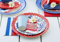 For easy clean-up, mix and match assorted patterns of paper plates, cups, and napkins to create a patriotic table setting. (Photo: Better Ho...