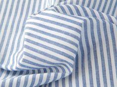 Summer stripes. This woven cotton poplin stripe fabric is ideal for a summer dress or shirt. #cottonpoplin #summerstripes #dressmaker