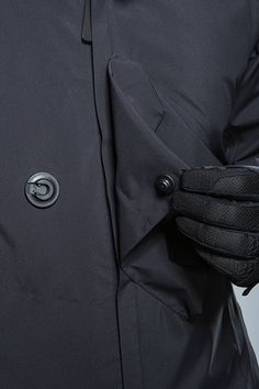 Pulled back by two layers of fabric its meant to keep together. Button, hook, jacket, water proof, black