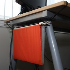 DIY: Make your own laptop hammock, for a dollar.  could make a more sophisticated version for our dining table at the living room