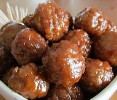 Slow Cooker Party Meatballs | AllFreeSlowCookerRecipes.com-If you're looking for super easy slow cooker frozen meatball appetizer recipes, this recipe for Slow Cooker Party Meatballs is perfect. Just add grape jelly and barbecue sauce and them cook!