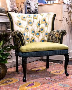Beautifully hand painted and hand stitched feathers, this petite channel back chair made a perfect canvas to create colorful Peacock feathers. Sitting in the chair gives you the feeling of being the p