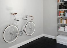 hanging bikes on wall - Google Search