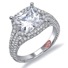 Designer Engagement Rings from DemarcoJewelry.com  Available in White or Yellow Gold 18KT and Platinum. 1.37 RD  Capture her grace and endless beauty with this confident yet elegant design. We have also incorporated a unique pink diamond with every single one of our rings, symbolizing that hidden, unspoken emotion and feeling one carries in their heart about their significant other.  This is not just another ring, this is a heirloom piece of jewelry.  Demarco Bridal Engagement…
