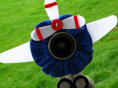 airplane lens pet.  $22 http://www.etsy.com/listing/68215575/custom-large-airplane-lens-pet-for-your