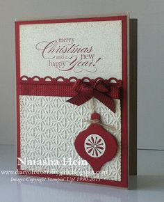 Christmas card...clean, elegant, red, embossed texture, lovely bow, hanging ornament...would be great to make the ornament two-sided so it could be removed and hung on the tree...