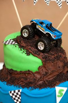 Monster Truck party - such a cool cake! - But add a race car instead ;) dana's boys would LOVE it--Lisa