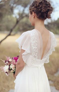 I don't want to wear a wedding dress, but I absolutely Love the back of this dress.