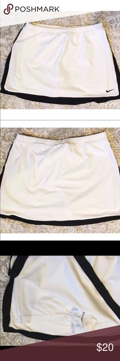Nike white Dri-Fit skirt Nike Dri-Fit skirt with built in shorts. White with black trim. Excellent condition! Nike Skirts