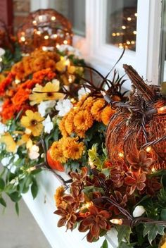 Inspiration Fall Decorations ...Love the pumpkin and twigs with lights...