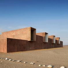Red concrete provides the geometric forms of this museum in Peru, designed by Barclay & Crousse to replace another destroyed during an earthquake.