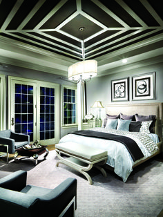 Add drama to your master bedroom with a high contrast, monochromatic color palette. Black and white makes for a sophisticated, luxurious interior design. Crown the room with an elegant chandelier. Shown: Nissé from Progress Lighting.